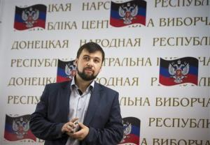 Insurgent leader Denis Pushilin at a news conference in Donetsk, Ukraine, Monday, May 12, 2014.
