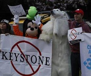 Activists protest the Keystone XL pipeline during a visit by President Barack Obama in Los Angeles, May 7, 2014.