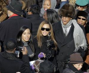 Jay-Z, Beyonce and Solange Knowles, left, stop for a photo as they try to find their seats as they arrive for the inauguration ceremony at the US Capitol in Washington, Tuesday, Jan. 20, 2009.