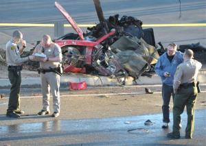 The wreckage of a Porsche sports car that crashed into a light pole in Valencia on Saturday, Nov. 30, 2013, killing Paul Walker and Roger Rodas, is shown.