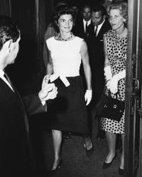 In this Aug. 17, 1961, file photo, Jacqueline Kennedy and her Cape Cod neighbor Bunny Mellon step into the lobby of the Colonial Theatre in Boston.
