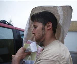 Philip Nelson leaves the Blue Earth Co jail in Mankato, Minn with a towel on his head after posting bail, May 12, 2014.