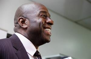 Magic Johnson smiles while speaking to members of the media April 29, 2014, in Saginaw, Mich.