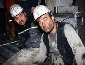 Two miners look around after being rescued hours after an explosion and fire at a coal mine in Soma, Turkey.