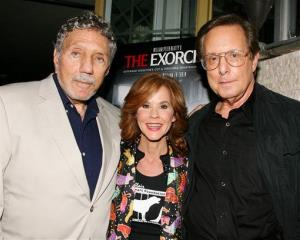 In this photo released by Starpix, The Exorcist author William Peter Blatty, left, joins Linda Blair and William Friedkin, the film's director, at a screening of the remastered film, Sept. 29, 2010.