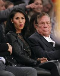 Los Angeles Clippers owner Donald Sterling, right, and V. Stiviano, left, watch the Clippers play the Los Angeles Lakers during an NBA preseason basketball game in Los Angeles on Monday, Dec. 19, 2010.