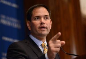 Sen. Marco Rubio, R-Fla. gestures while spaking during a luncheon program at the National Press Club in Washington, Tuesday, May 13, 2014. Younger voters would face higher retirement ages but all Americans could join federal retirement accounts in a plan proposed Tuesday by Sen. Rubio in his latest in a...