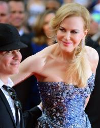 Director Olivier Dahan and Nicole Kidman pose on the red carpet for the opening ceremony and screening of Grace of Monaco at the 67th international film festival, Cannes, southern France, May 14, 2014.