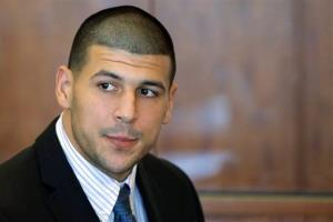 In this Oct. 9, 2013 file photo, former New England Patriots player Aaron Hernandez attends a pretrial court hearing in Fall River, Mass.