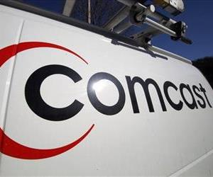 This Feb. 11, 2011, file photo, shows the Comcast logo on one of the company's vehicles, in Pittsburgh.