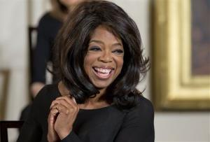 In this Nov. 20, 2013, file photo, Oprah Winfrey smiles before being awarded the Presidential Medal of Freedom by President Barack Obama in the East Room of the White House in Washington.