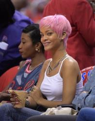 Singer Rihanna watches the Los Angeles Clippers play the Oklahoma City Thunder in the second half of Game 6 of the Western Conference semifinal NBA basketball playoff series, Thursday, May 15, 2014, in Los Angeles.