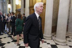 Sen. Thad Cochran, R-Miss., arrives at the Senate chamber for a vote, Wednesday, May 14, 2014, on Capitol Hill in Washington.