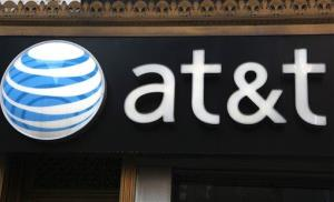 An AT&T sign is seen at a store in New York.