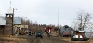 In this May 7, 2014, file photo, residents make their way along First Street in Tanana, Alaska. Without a jail or armed law enforcement, the isolated Alaska village is turning to banishment.