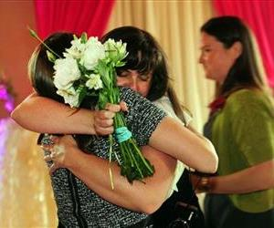 Julia Fraser hugs a family member after getting married as Jessica Rohrbacher, right, walks behind after get married at the Melody Ballroom in Portland, Ore., May 19, 2014.