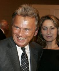 Wheel of Fortune host Pat Sajak, left, arrives at a reception at the Beverly Hilton hotel after the funeral of entertainer and producer Merv Griffin in Beverly Hills, Calif., Friday, August 17, 2007.
