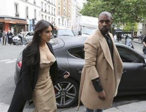 Kim Kardashian and Kanye West arrive at a luxury shop in Paris, Wednesday, May 21, 2014.