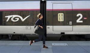 A passenger runs to take an high-speed train  at Saint-Charles railway station, in Marseille, southern France, Thursday, June 13, 2013.
