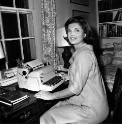 In this Oct. 5, 1960, file photo, Jacqueline Kennedy poses at her typewriter in her Georgetown home in Washington.