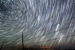 Perseid meteors, upper left, streak past time-lapse-captured stars early Tuesday morning, Aug. 13, 2013 north of Cheyenne, Wyo.