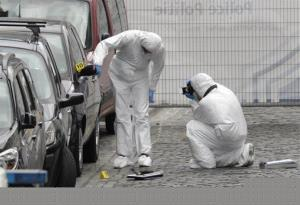 Forensic experts examine the site of a shooting at the Jewish museum in Brussels, Saturday, May 24, 2014.