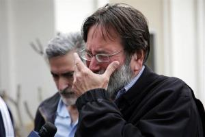 Richard Martinez, who says son Christopher Martinez was killed in Friday's mass shooting in Isla Vista, Calif., breaks down as he speaks Saturday, May 24, 2014.