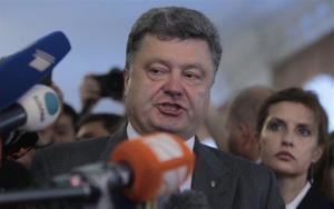 Ukrainian presidential candidate Petro Poroshenko, speaks to press at a polling station during the election in Kiev, Ukraine, Sunday, May 25, 2014.