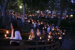 People gather at a park in Isla Vista, California for a candlelight vigil to honor the victims of Friday night's mass shooting.
