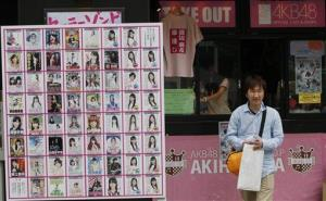 A man shops at an AKB48 cafe and shop in Tokyo's Akihabara district today.