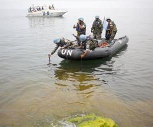 Uruguayan United Nations Peace Keepers probe the shores of lake Kivu in Goma, eastern Congo, Tuesday Aug. 7, 2012.