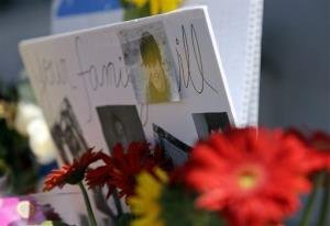 Images of shooting victim Ross Michael-Martinez are displayed as part of a makeshift memorial in front of the IV Deli Mart, where part of Friday night's mass shooting took place.