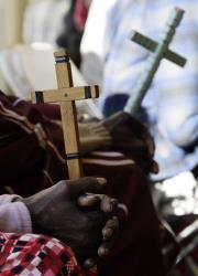 Southern Sudanese hold crosses as they wait to vote in the Southern Sudan Referendum at polling center in Chicago, Sunday, Jan. 9, 2011.