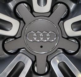 The logo of German car producer Audi is seen on the wheel of a Audi RS 8 sportscar.