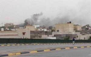 Smoke rises after troops loyal to Gen. Khalifa Haftar targeted Islamist lawmakers and officials at the parliament in Tripoli, Libya, Sunday, May 18, 2014.