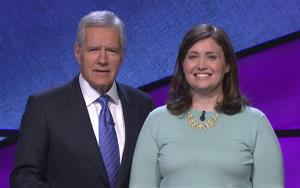 In this photo provided by Jeopardy Productions, Inc., Alex Trebek poses with Julia Collins, 31, during the taping of her shows on stage at JEOPARDY!, Sony Pictures Studios, Culver City, Calif.