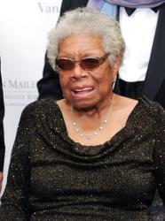 In this Oct. 17, 2013 file photo, Maya Angelou poses for photographers during the fifth annual Norman Mailer Center benefit gala at the New York Public Library.