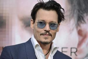 Johnny Depp arrives at the LA premiere  Of Transcendence on Thursday, April 10, 2014, in Los Angeles.