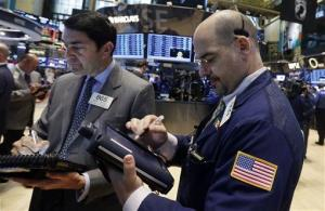Traders Mark Muller, left, and Luigi Muccitelli work on the floor of the New York Stock Exchange Tuesday, May 27, 2014.
