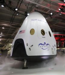 The SpaceX Dragon V2 spaceship is unveiled at its headquarters on Thursday, May 29, 2014, in Hawthorne, Calif.