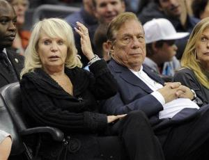 In this 2010 photo, Shelly Sterling sits with her husband, Donald Sterling, during a game.