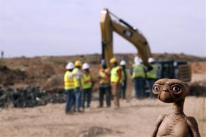 In this April 26 photo, an E.T. doll is seen while construction workers prepare to dig into a landfill in Alamogordo, N.M.