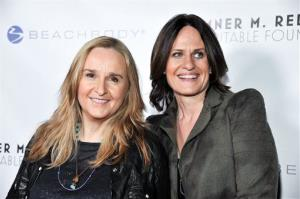 Melissa Etheridge, left, and Linda Wallem arrive at the 6th Annual Go Go Gala at the Bel Air Bay Club in this Nov. 14, 2013 file photo.