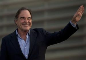 Oliver Stone waves during a photocall for the 61st San Sebastian Film Festival, in San Sebastian, northern Spain last fall.