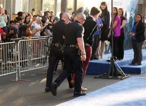 In this Wednesday, May 28, 2014 file photo, Vitalii Sediuk is walked off carpet in handcuffs after allegedly attacking Brad Pitt at the world premiere of Maleficent at the El Capitan Theatre in Los Angeles.