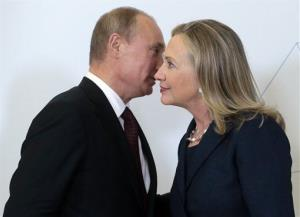 Russian President Vladimir Putin,meets Hillary Clinton on her arrival at the 2012 APEC summit in Vladivostok, Russia.