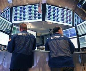 In this Tuesday, Aug. 23, 2011 file photo, Bank of America Merrill Lynch traders work on the floor of the New York Stock Exchange in New York.
