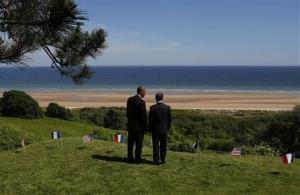 President Obama and French President Francois Hollande look out at Omaha Beach at Normandy American Cemetery, Friday, June 6, 2014.