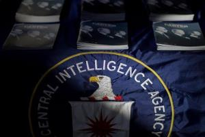 Packets containing declassified documents by the CIA sit on a table at an event marking the declassification at the Carter Center, Wednesday, Nov. 13, 2013, in Atlanta.
