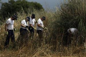 British police search in Praia da Luz, Lagos, southern Portugal, Friday.